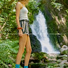 Dark New Zealand bush clad area withyoung modern woman at waterfall      Model Released; Yes