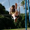 Teenage girl enjoys playing in children's playground.