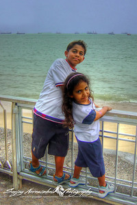 Kethan & Vasantha overlooking the port of Singapore March 25, 2004