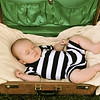 Baby Luke, asleep in an antique suitcase.  Three month old baby portrait.