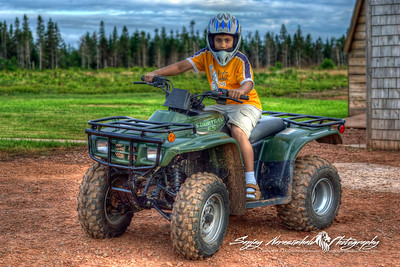 Kethan and his ATV in Prince Edward Island July 29, 2005