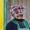 A lady in the Townships near Port Elizabeth forms part of a workparty of volunteers to help paint the interior of a shipping container as they cconvert it into a kindergarten classroom. They paint their faces to celebrate their individuality.