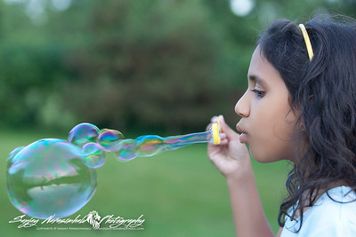 Vasantha blowing bubbles, Prince Edward Island, August 1, 2005