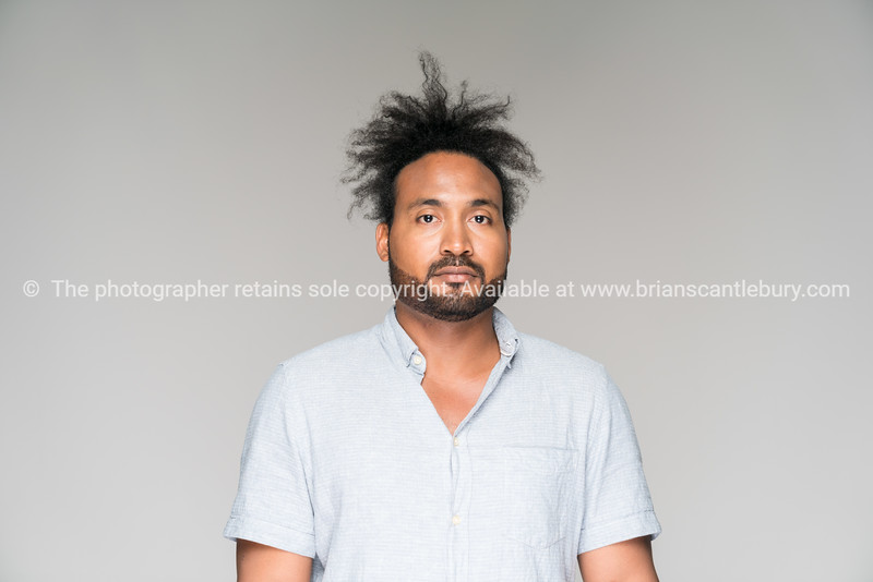 Black man with frizzy hair in knot Model Released; Yes.