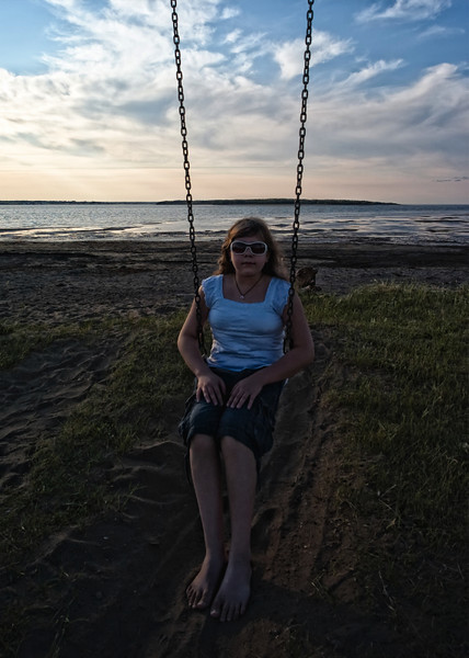 A swing at sunset at the summer home.