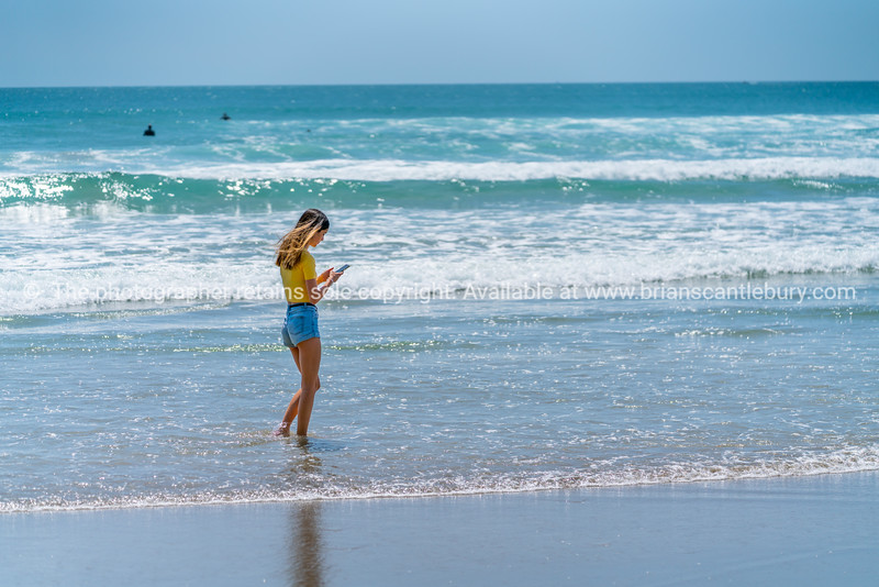 Teenage girl standing on beach