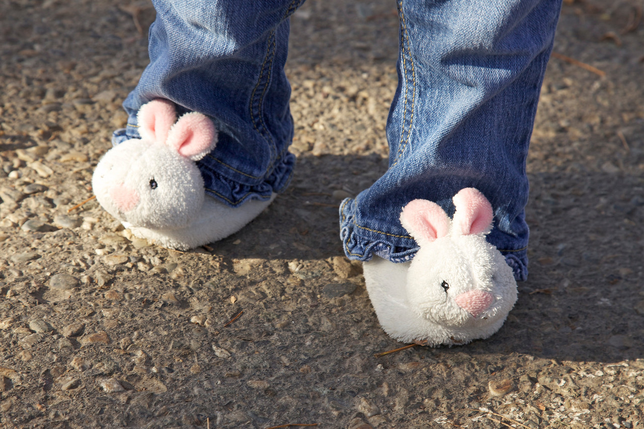 Bunny slippers! We started taking pics before Miss A had changed into her dress shoes. I just thought they were cute. :)