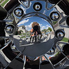 Playing with reflections...  I liked the clouds in the sky behind me and I like how shiny the chrome wheels are.  :)