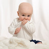 Beautiful Baby Boy with White Background & Blanket in Studio