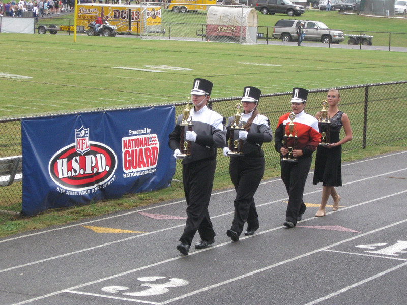 Our band reps bringing the trophies home - in step, of course