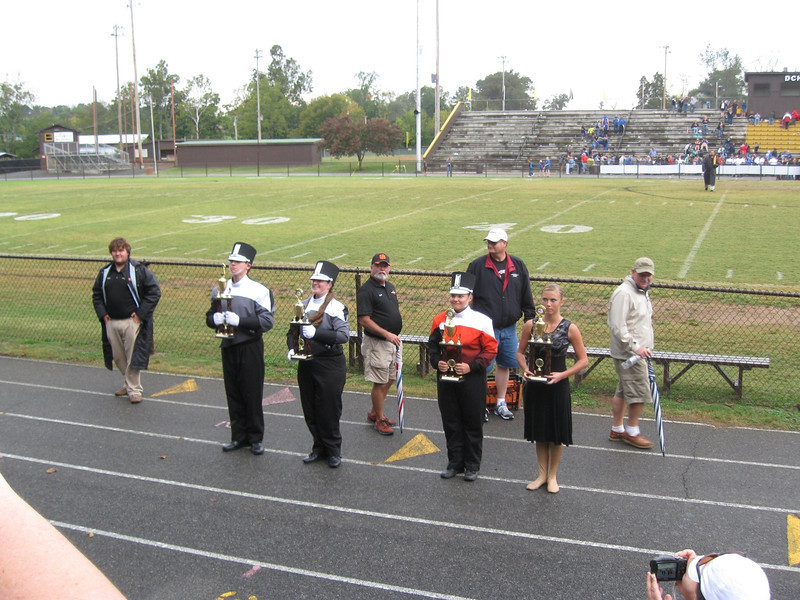 Presenting trophies to the band