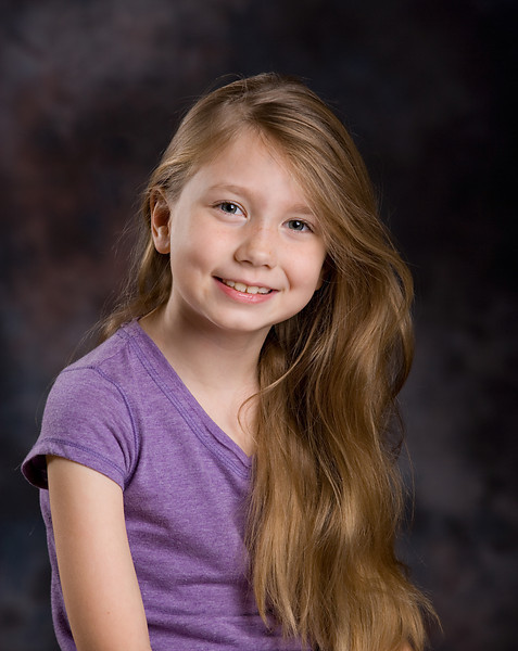 Traditional portrait lighting and backdrop in the studio.
