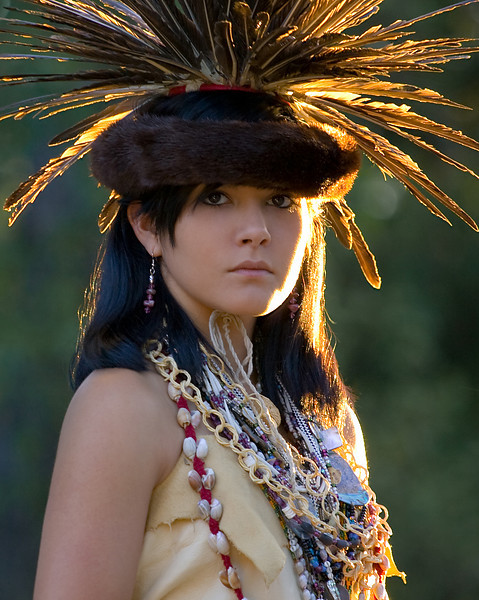 Kazzy wearing traditional dance regalia on her family's property in the Sierra Foothills.