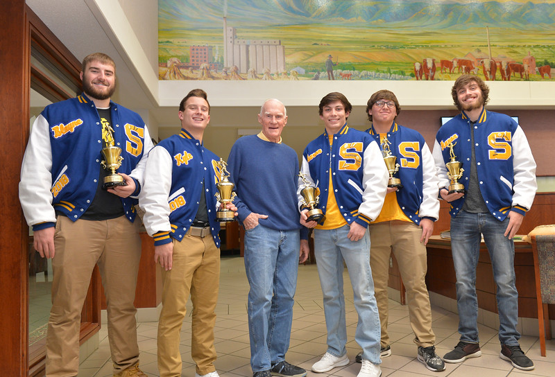 Justin Sheely | The Sheridan Press	<br /> Homer Scotty Scott, Jr., center congratulated Sheridan High School Bronc football players, from left, Blayne Baker, Kyle Custis, Arron Sessions, Connor Jorgenson and Aaron Woodward.