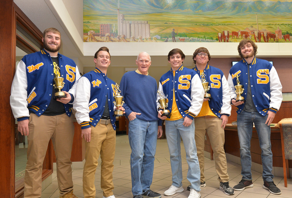 Justin Sheely | The Sheridan Press<br /> Homer Scotty Scott, Jr., center congratulated Sheridan High School Bronc football players, from left, Blayne Baker, Kyle Custis, Arron Sessions, Connor Jorgenson and Aaron Woodward.