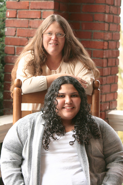 I would like to introduce you to Doreen and Kristen Castro-Nevius.  Kristen graduated from GHS in 2011.  In November of 2012 Kristen lost her mom and best friend.  She had not been sick and it was not expected.  Her husband kissed her goodbye in the morning and talked about what their evening plans were.  An hour later her daughter's found her with her bible in hand - she was gone.  This was the last picture Kristen had of her and her mom - it's priceless.  Because of this I made a promise to Kristen  - I now insist that every senior has 1 or 2 pictures taken with their mom or dad or both.  We don't know what the future holds...so for your child ...step up and smile - you will be glad you did .