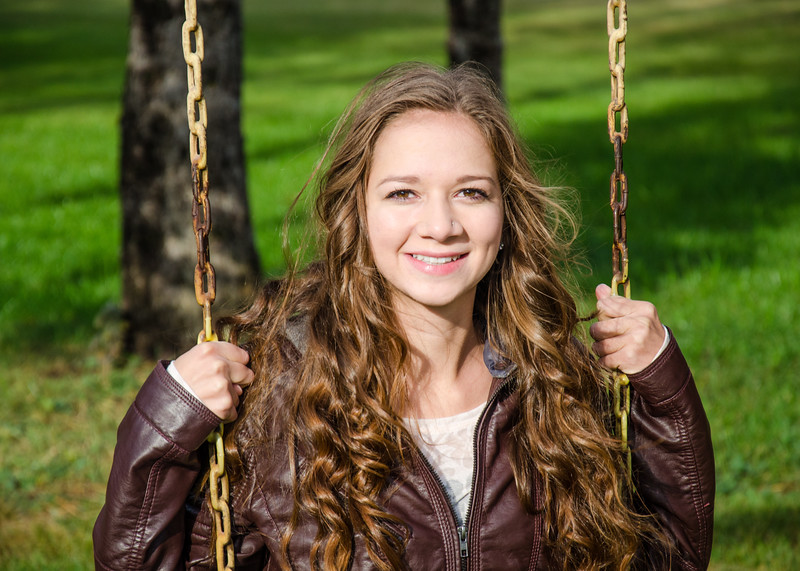 Senior portrait of girl on swing