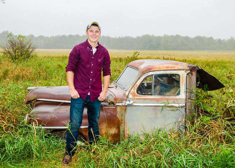 senior guy with old car photo