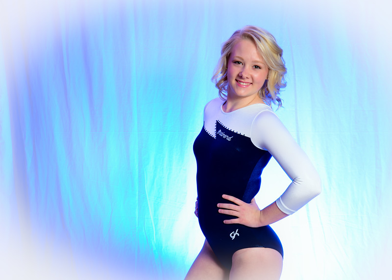 Senior portrait of girl in blue gymastics leotard