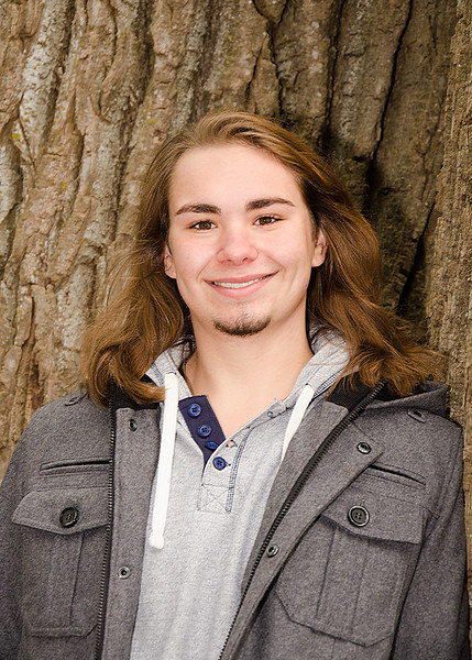 Senior portrait of guy on tree