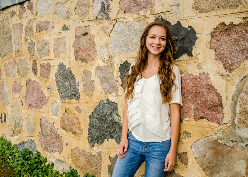 Senior portrait of girls in front of rock wall