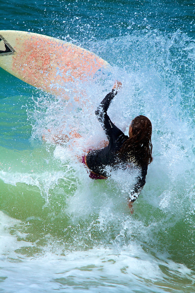 Heather came in hot for a big wave but the impact threw her off the board. Made for a nice photo though.
