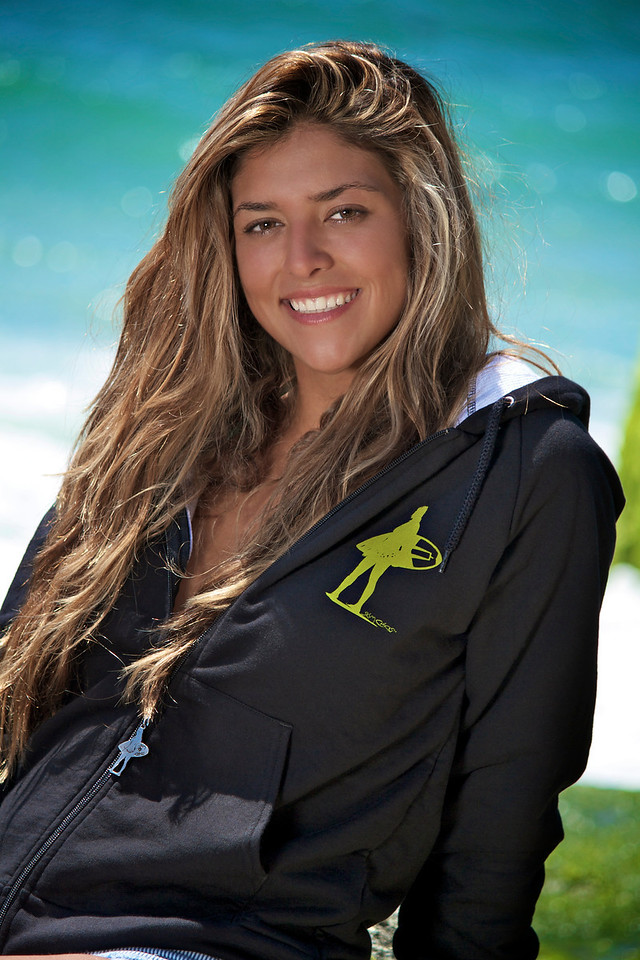 This is Silvia. She traveled to the competition from Ft. Lauderdale, Florida. She is modeling the Skim Chicks black and white hoodie with zipper pull.