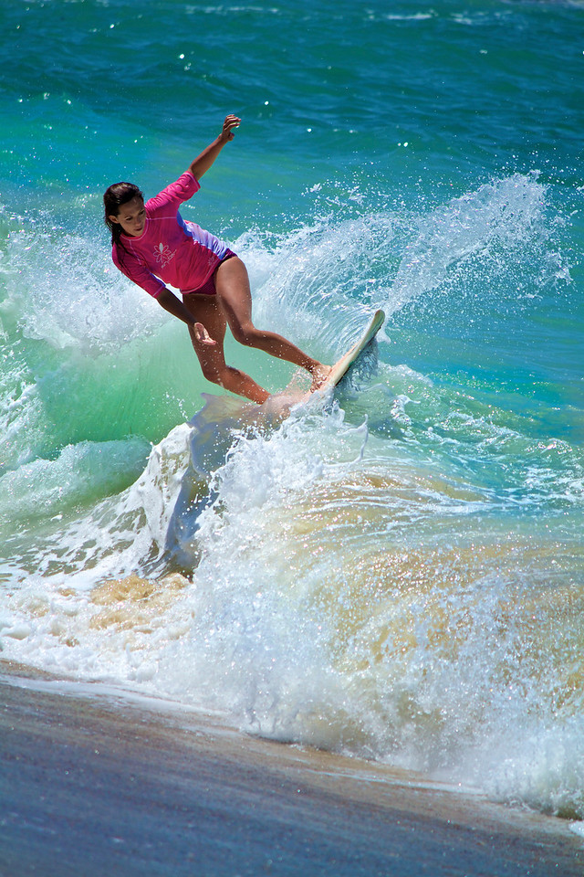 Heather cutting up the surf.