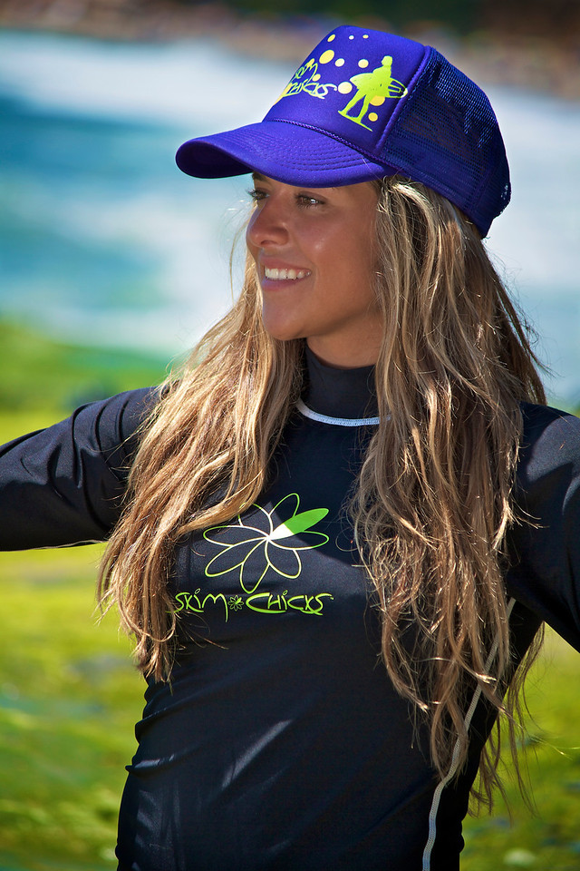 Silvia wearing the Skim Chicks long sleeve black rash guard and purple cap.