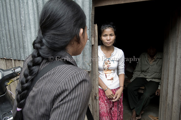 Scre Oun, 23, a sex worker talks to a social worker from AFESIP. Her father who has no knowledge about her works sits in the background. He has got some money from his daughter.<br /> AFESIP (in French: Agir pour les Femmes en Situation Precaire - In English: Acting for Women in Distressing Situations), founded by her former husband Pierre Legros and Somaly Mam, is an international NGO combatting trafficking in women and children for sex slavery.