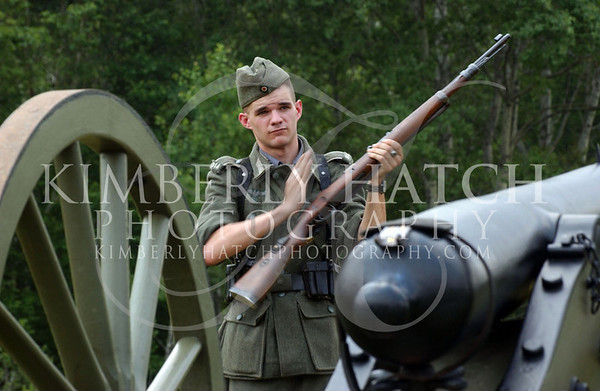 Vance Anderson of Maynard, MA cycles, loads and fires a standard rifle that was used by the German army during WWII.  The 22nd annual International Time Line Saturday in Wilmington.  (Kimberly Hatch/Reformer)