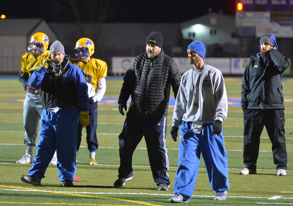 Justin Sheely | The Sheridan Press<br /> Head coach Don Jullian, left, runs a drill during practice Thursday night with assistant coaches Kevin Rizer, Jeff Mowry and Marshall McEwen.