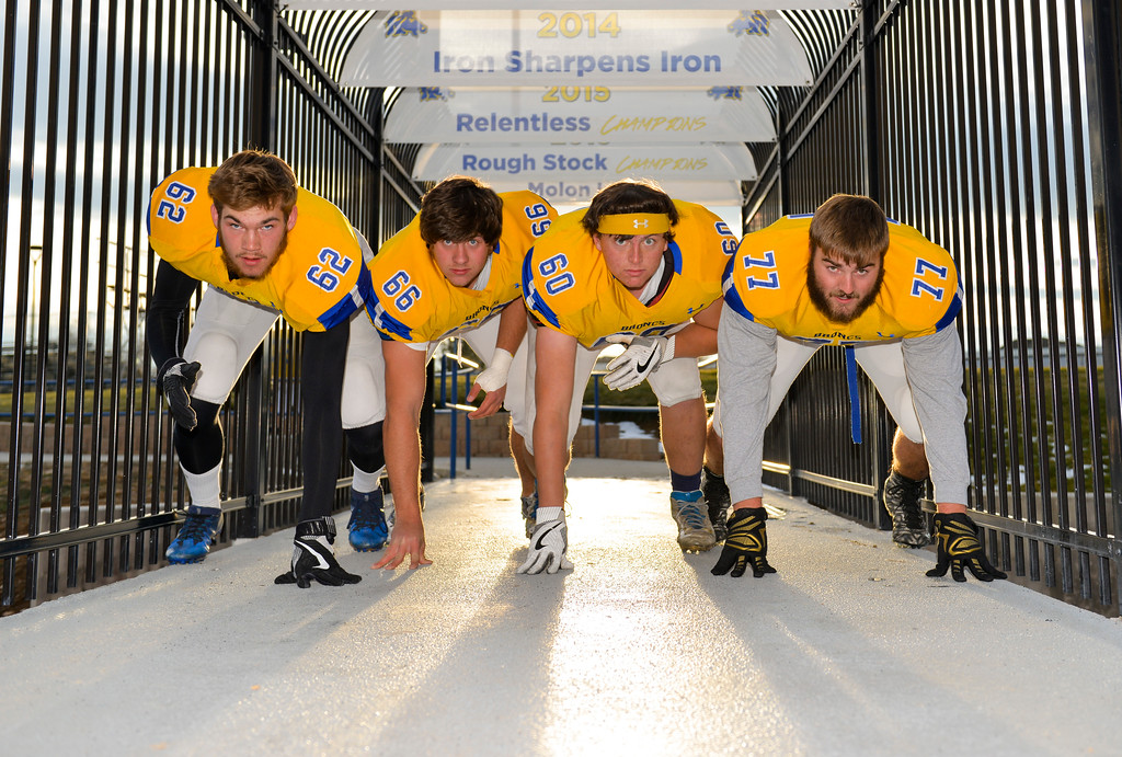 Justin Sheely | The Sheridan Press<br /> Sheridan High School's starting defensive linemen, from left: Quinton Brooks, Max Myers, Connor Jorgenson and Blayne Baker block the skywalk leading to Homer Scott Field.