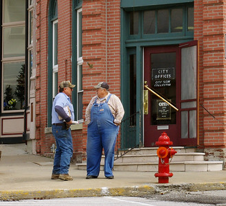 Locals chat in front of the Glasgow (Missouri) Bank.