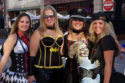 Four fantastic ladies and a mechanical munchkin - Octoberfest, downtown Springfield, MO, 10/1/11. I'd say it's about time the tyke was off the tit - she's ready for some solid food.