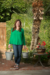 EXETER--- Tiffany Nielsen collects rainwater from her roof to water plants which she plants in her garden and in her yard.