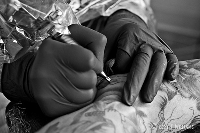 The finishing touches are made by tattoo artist Tex to Andrew's sleeve, at Authentic Tattoo, in San Francisco. © Cody T Williams.