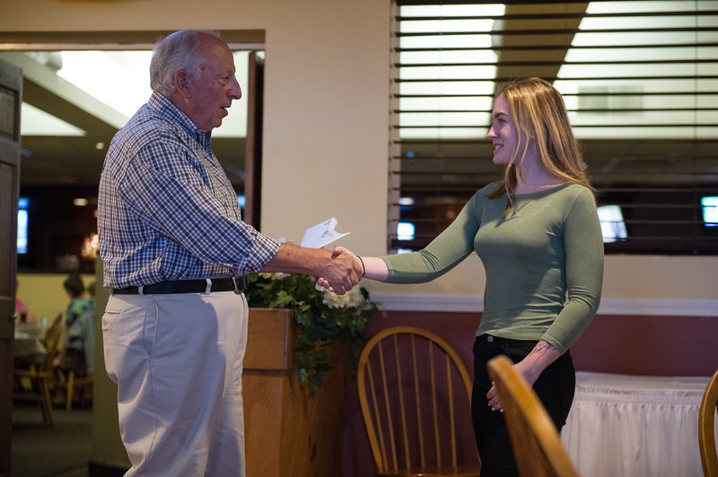 8/22/16 FITCHBURG--Slattery's owner Dave Celuzza hands Heather Hunt her scholarship award on Monday night at Slattery's in Fitchburg.  Sentinel & Enterprise photo/Jeff Porter