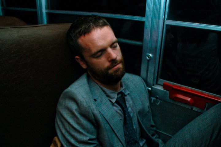 Man sleeping in bus, New York, NY, 2010.