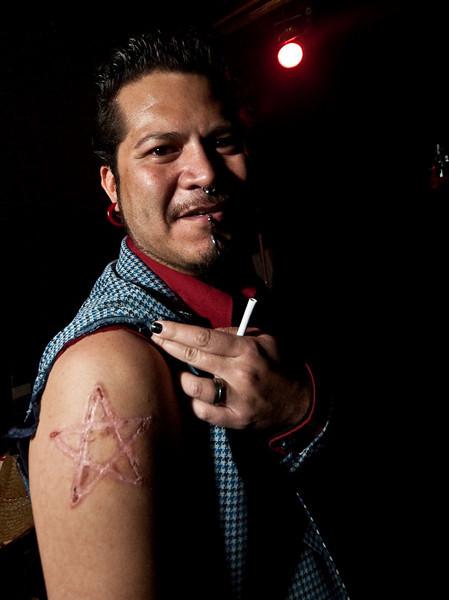 Man tattooed by crystal ball in the sun, Vegas, Nevada, 2009