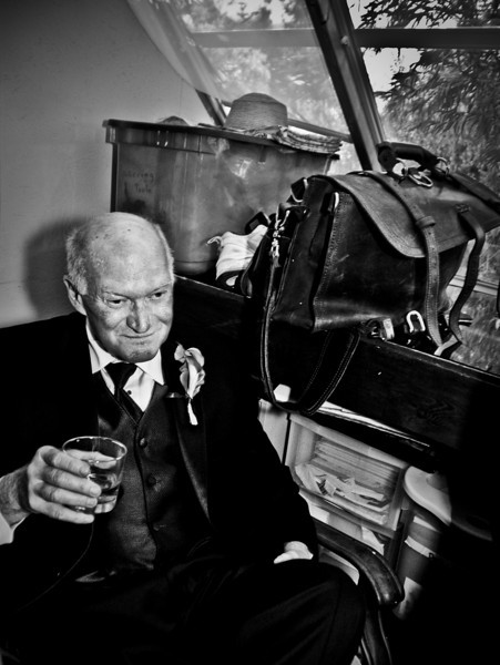 Best man having a drink before wedding, Los Angeles, California, 2010.