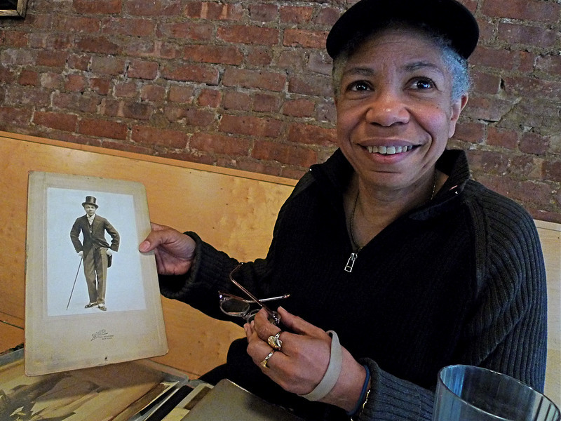 Melanie Edwards, showing photo of her grandfather, J. Rosamond Johnson