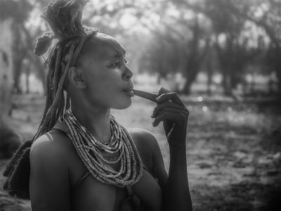 Woman Smoking a Pipe