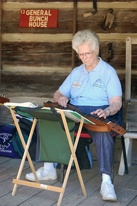 Sue Brummett Playing a Dulcimer
