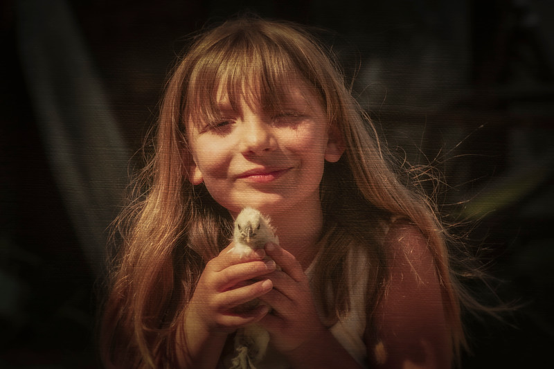 Child with Chick