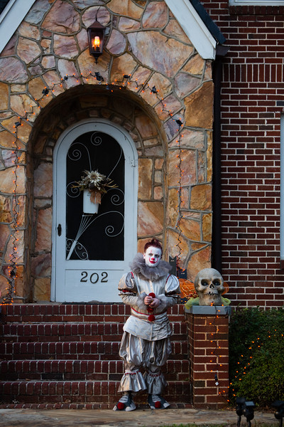 Nadav Soroker/Times-Georgian  Charlie Doxey, 11, hands out candy to Trick or Treaters along Cedar St. on Halloween, on Wednesday, October 31, 2018.
