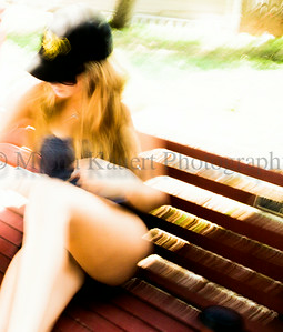 Girl on Bench in Summer