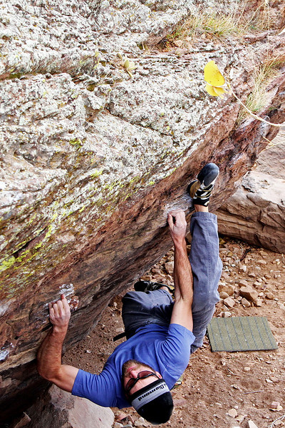 This is called 'bouldering' -- it's a type of  technical climbing that is done on large rocks.