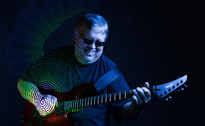 Guitarist Tom Feltner photographed by Sam Breach, 2014