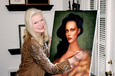 Morgan finishing her oil painting of her friend Glinda